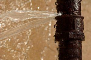 Rusty burst pipe in Baku Botanic Garden
