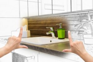 concept-drawing-of-new-bathroom-fixtures-with-hands-held-up-in-forefront