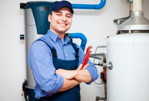 technician-servicing-hot-water-heater